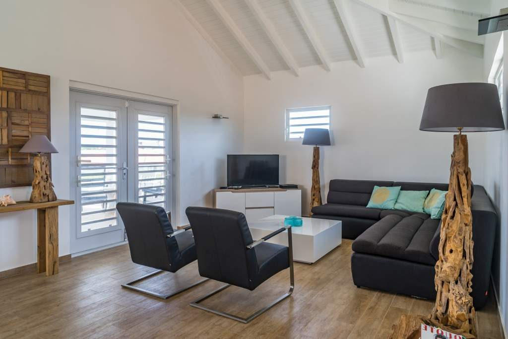 Vakantie Villa Curacao woonkamer. Het vriendelijk Curaçao wacht op u.